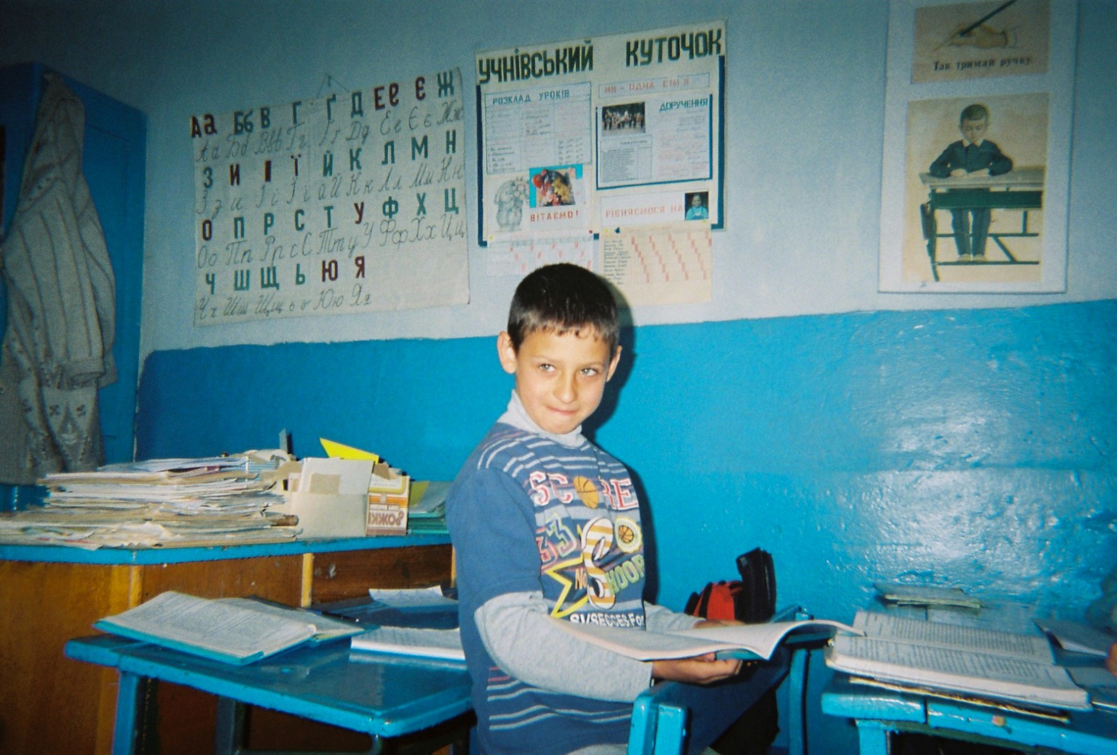 A school boy stands in his classroom in Orane village, a few kilometres from the Chernobyl Exclusion Zone