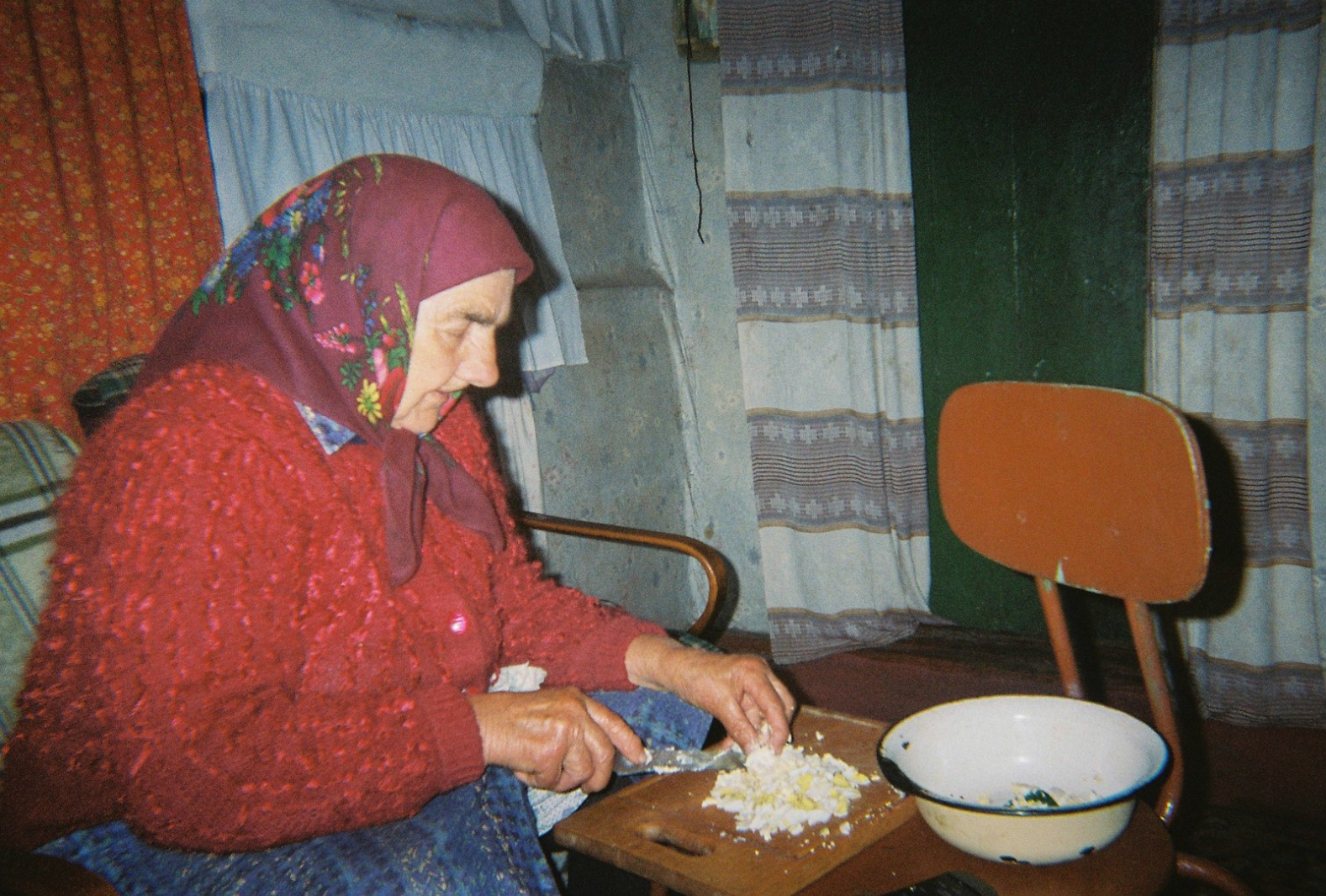An elderly lady prepares home-grown food in her home near Chernobyl