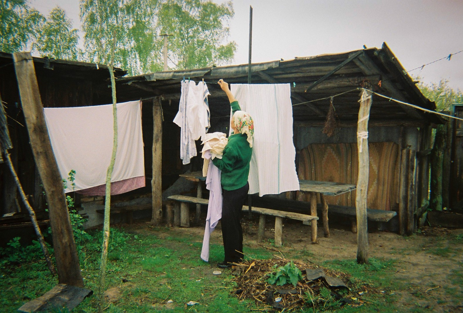 A woman hangs washing in her garden near Chernobyl