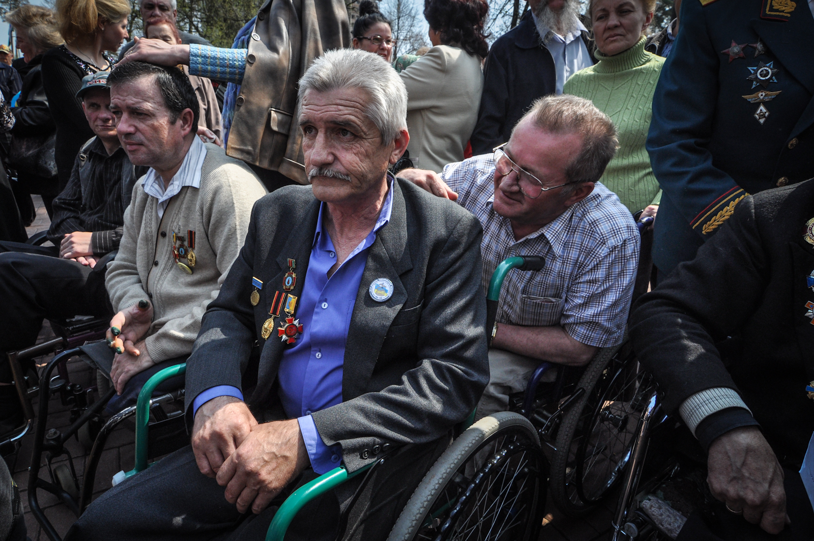 Disabled liquidators at a memorial to the Chernobyl disaster. Many feel abandoned by the State, receiving little or no compensation