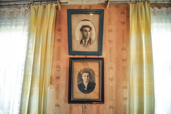 Family portraits in a house next to the nuclear Exclusion Zone in Ukraine. Each house holds a story.