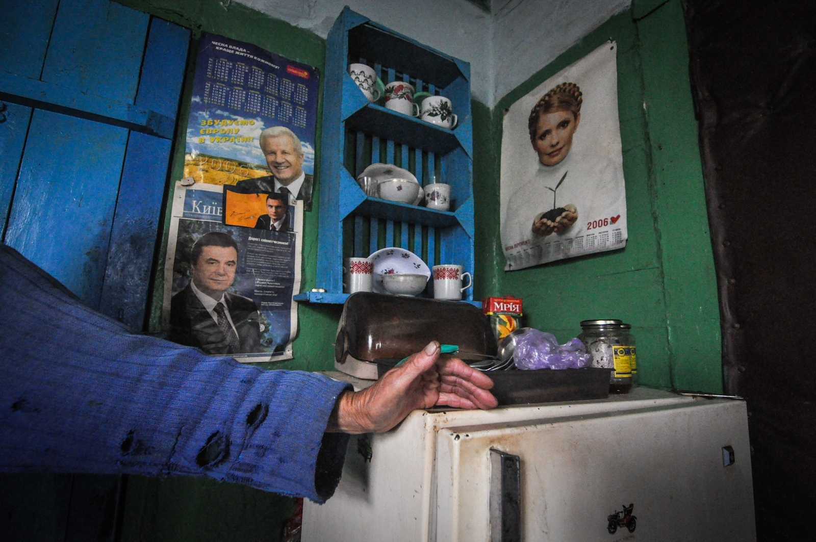 A kitchen near Chernobyl: photos of deposed president Viktor Yanukovych (left) and political rivals Yulia Timoshenko and Vitali Klitschko