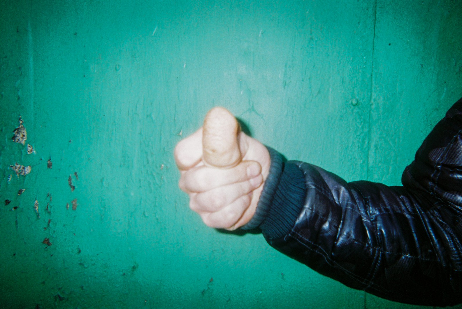 A photograph of a man's thumb south of the Chernobyl Exclusion Zone