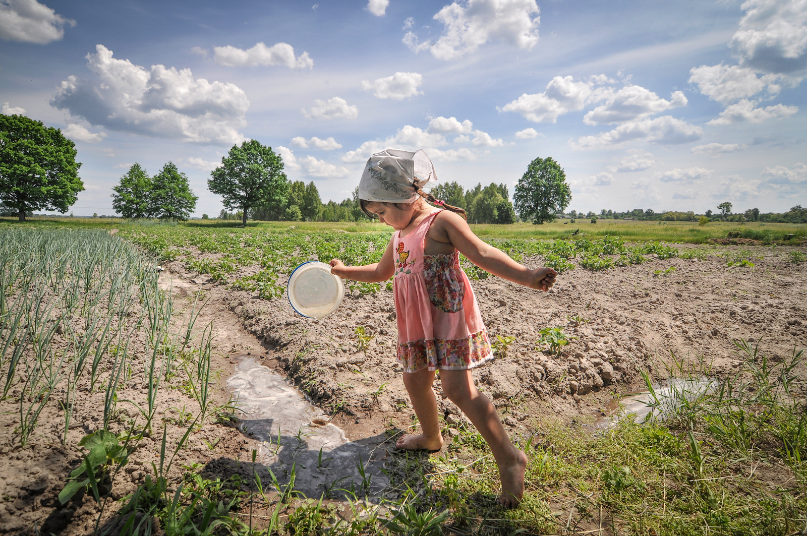 A young girl plays on her grandparents small farm near the border of the Exclusion Zone in Ukraine.