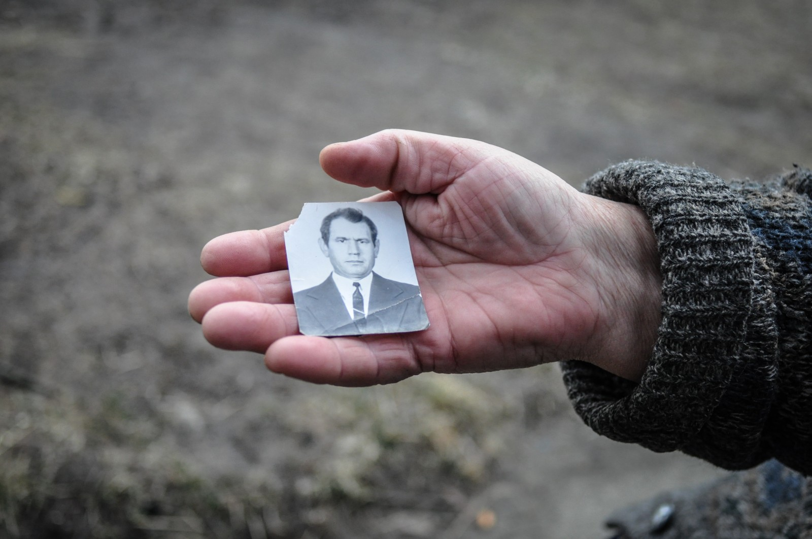 A 'Chernobyl widow' holds a photograph of her late-husband. She says he died from radiation exposure after working as a liquidator after the accident.