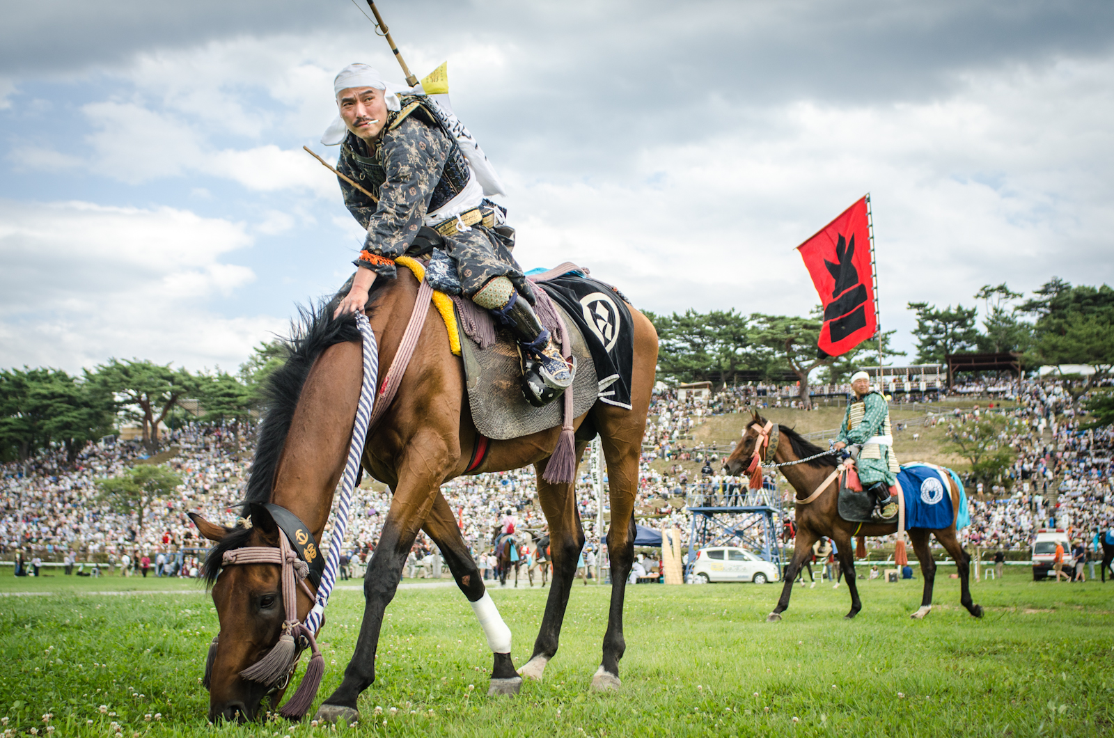 Samurai warriors wait on their horses before competing in traditional games