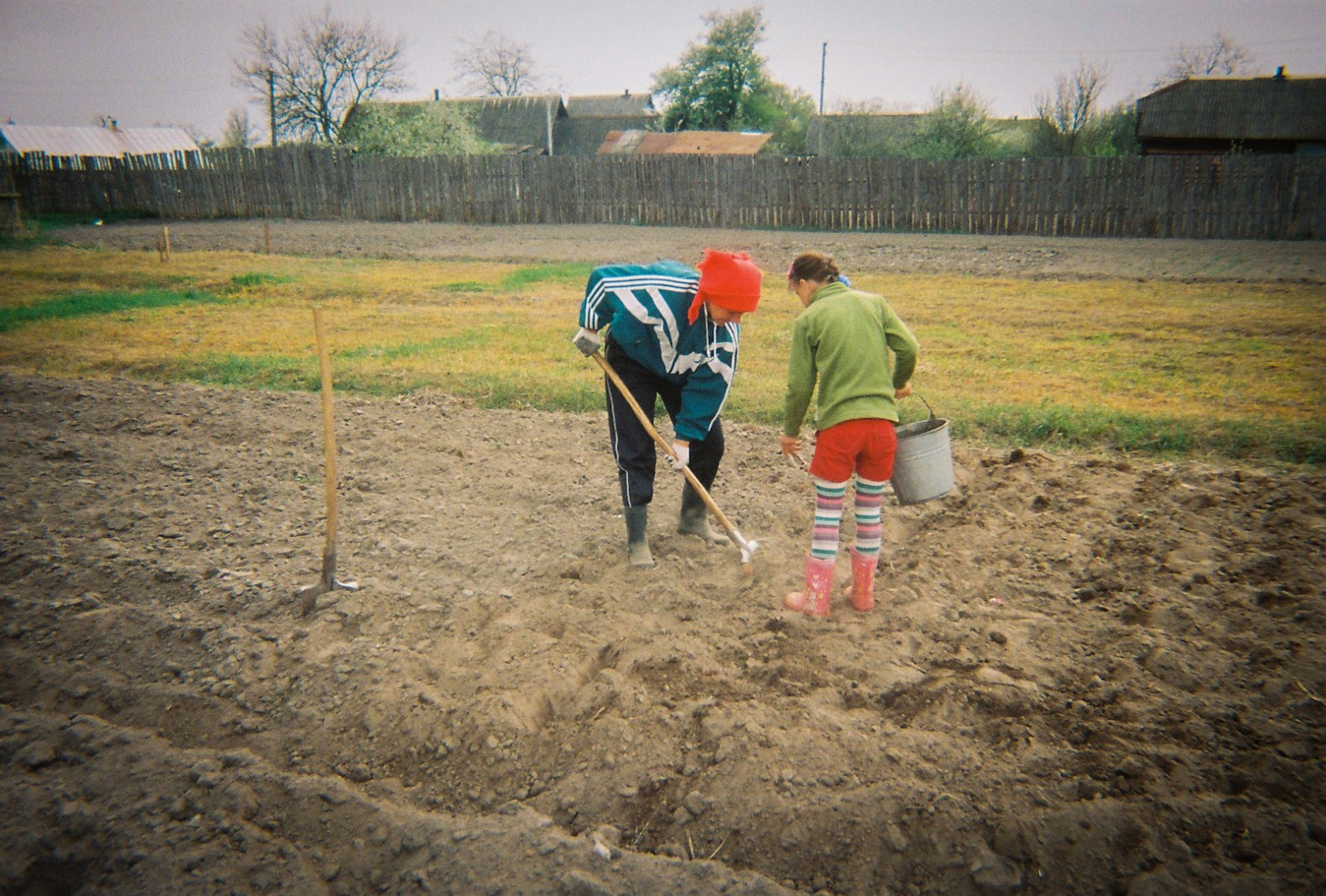 A mother and her daighter plant potatoes during April, the same month that Chernobyl polluted this landscape almost thirty years earlier